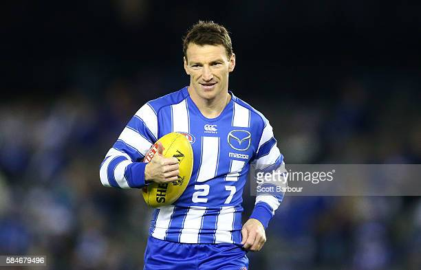 Brent Harvey of the Kangaroos in his longsleeved jumper warms up before the round 19 AFL match between the North Melbourne Kangaroos and the St Kilda...