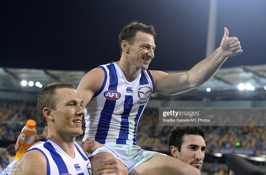 Brent Harvey of the Kangaroos is chaired off after his 400th AFL match after the round 17 AFL match between the Brisbane Lions and the North Melbourne Kangaroos at The Gabba on July 25, 2015 in Brisbane, Australia.