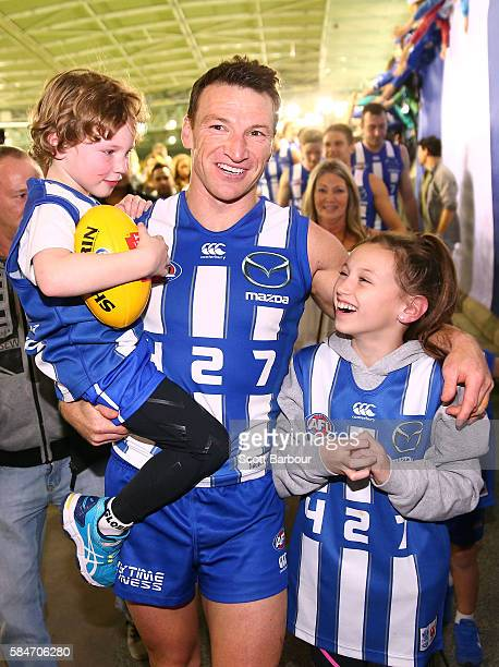 Brent Harvey of the Kangaroos is congratulated his children Lacie Harvey Cooper Harvey and Hudson Harvey as he leaves the field after the round 19...