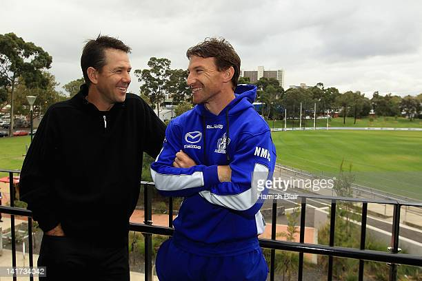 Brent Harvey of the Kangaroos laughs with Australian cricket player Ricky Ponting after a press conference at Aegis Park on March 23 2012 in...