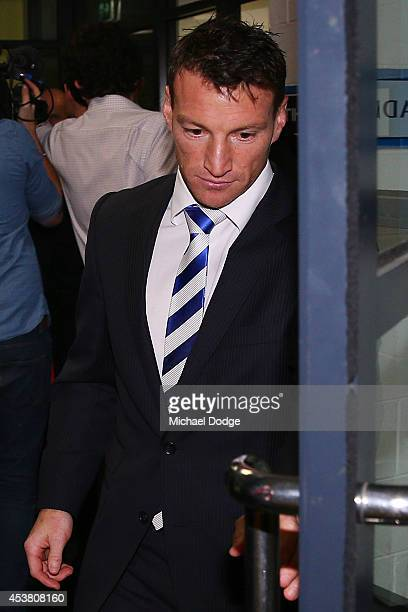 Brent Harvey of the Kangaroos leaves after receiving a three week suspension at the AFL tribunal hearing at AFL House on August 19 2014 in Melbourne...