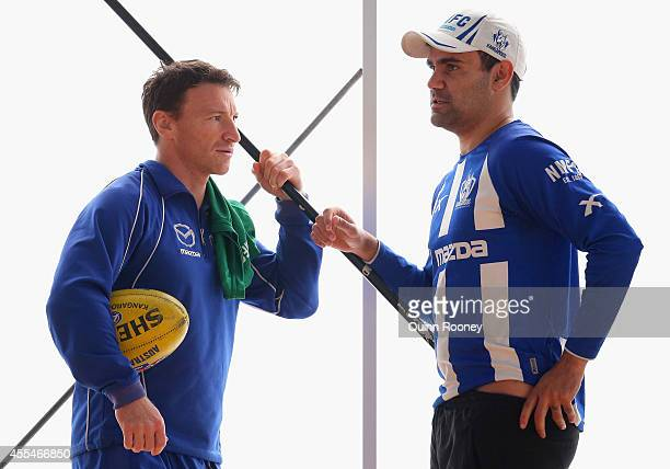 Brent Harvey of the Kangaroos talks to Lindsay Thomas during a North Melbourne Kangaroos AFL training session at Arden Street Ground on September 15...