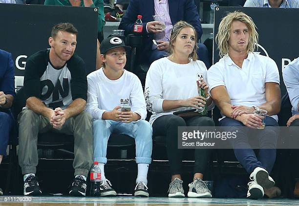 Brent Harvey of the North Melbourne Kangaroos and Dyson Heppell of the Essendon Bombers and his partner Kate Turner watch from the crowd during the...
