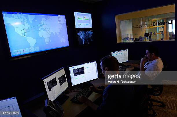 Brent Henderson middle and Erich Rojas right security technicians in the Security Operation Center at Level 3 Communications monitor continuos...