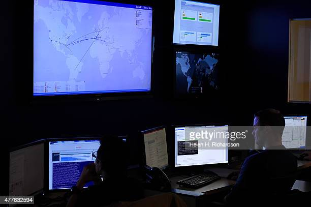 Brent Henderson right a security technician in the Security Operation Center at Level 3 Communications monitors continuos malware phishers and...
