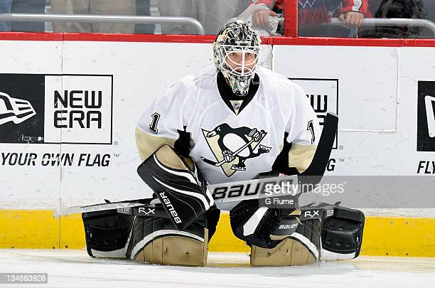 Brent Johnson of the Pittsburgh Penguins warms up before the game against the Washington Capitals at the Verizon Center on December 1, 2011 in...
