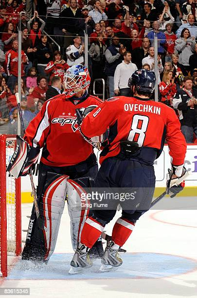 Brent Johnson of the Washington Capitals is congratulated by Alex Ovechkin after saving a penalty shot by Chris Drury of the New York Rangers in the...