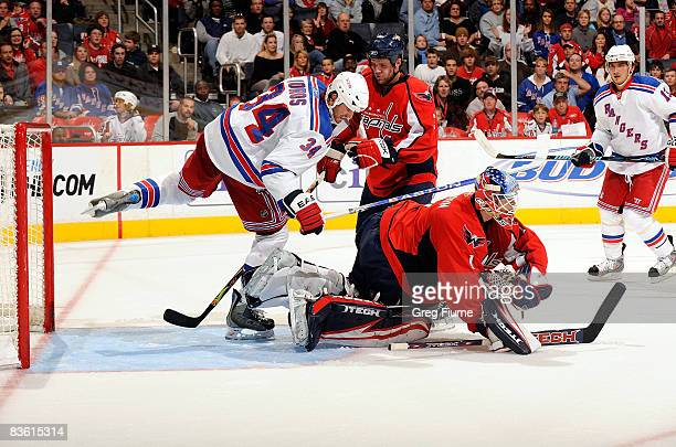 Brent Johnson of the Washington Capitals makes a save in front of Aaron Voros of the New York Rangers November 8, 2008 at the Verizon Center in...