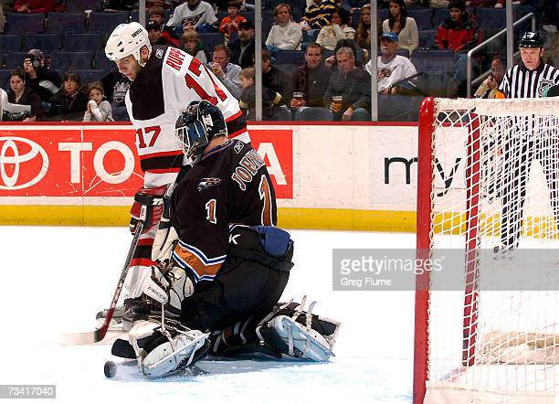 Brent Johnson of the Washington Capitals saves a shot by Mike Rupp of the New Jersey Devils on February 25 2007 at the Verizon Center in Washington DC