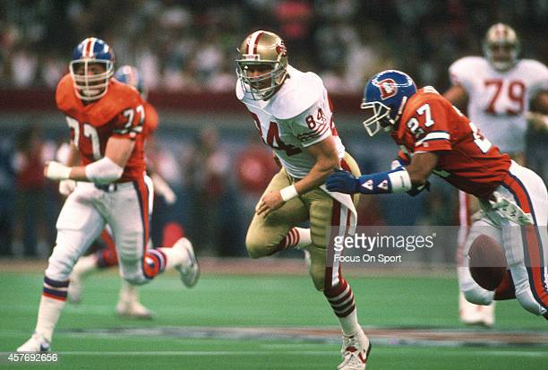 Brent Jones of the San Francisco 49ers can't make the catch while defended by Steve Atwater of the Denver Broncos during Super Bowl XXIV on January...