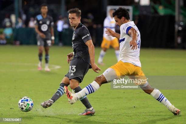 Brent Kallman of Minnesota United fights for the ball with Oswaldo Alanis of San Jose Earthquakes during a quarter final match of MLS Is Back...