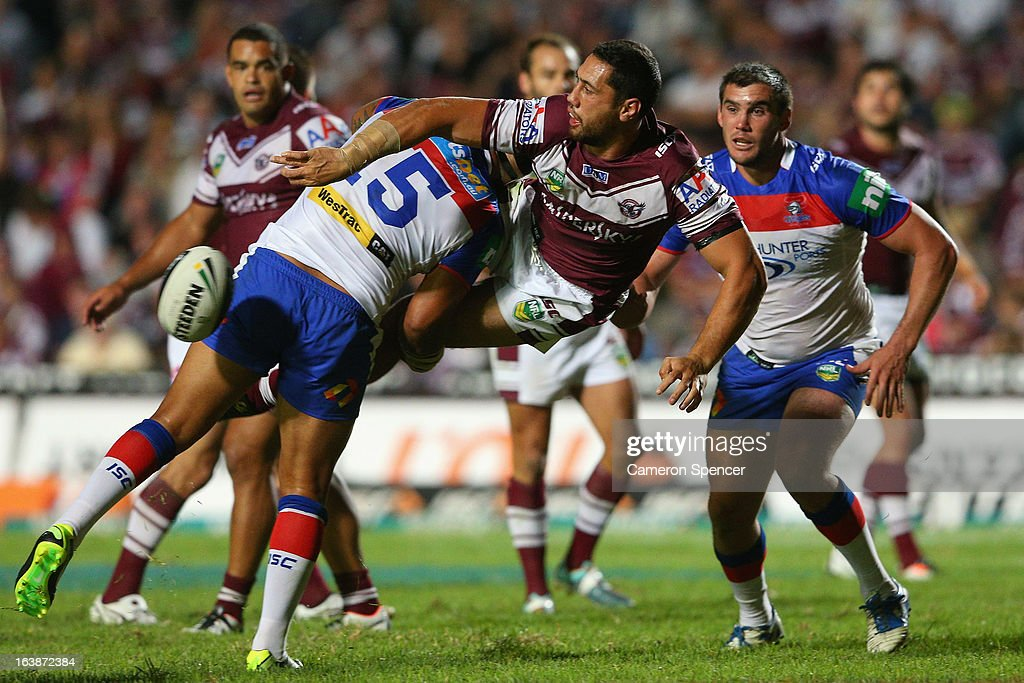 Brent Kite of the Sea Eagles offloads the ball in a tackle during the round two NRL match between the Manly Sea Eagles and the Newcastle Knights at Brookvale Oval on March 17, 2013 in Sydney, Australia.