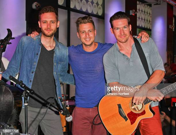 Brent Kutzle Ryan Tedder and Zach Filkins of OneRepublic at the MLB Fan Cave on August 9 2012 in New York City