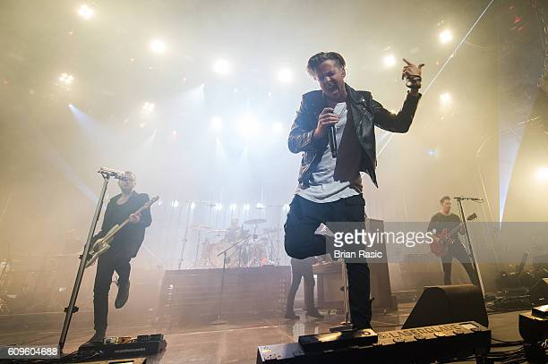 Brent Kutzle Ryan Tedder and Zach Filkins of OneRepublic perform at the Apple Music Festival at The Roundhouse on September 21 2016 in London England