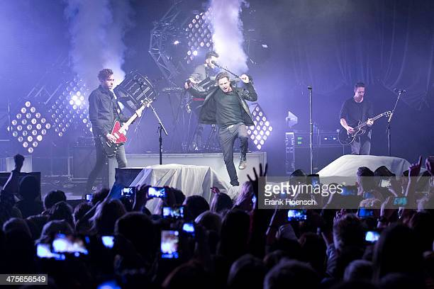 Brent Kutzle Ryan Tedder and Zach Filkins of OneRepublic perform live during a concert at the Columbiahalle on February 28 2014 in Berlin Germany