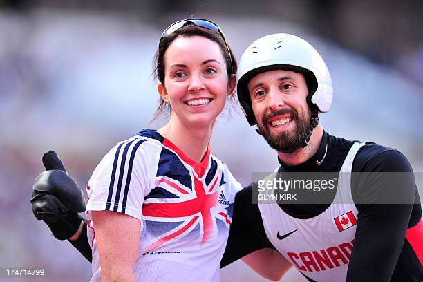 Brent Lakatos of Canada and his wife Stefanie Reid pose for photographs after he won the mens T53 100 metres event during the International Para...