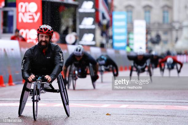 Brent Lakatos of Canada celebrates as he crosses the finish line in first place in the Wheelchair race during the 2020 Virgin Money London Marathon...