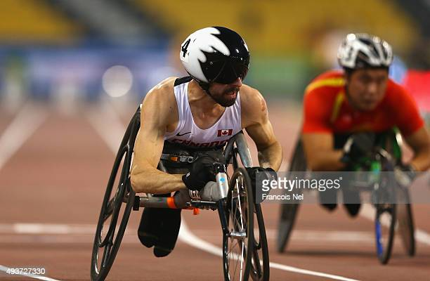 Brent Lakatos of Canada claims victory in the Men's 100m T53 Final during the Evening Session on Day One of the IPC Athletics World Championships at...