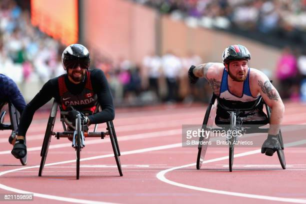 Brent Lakatos of Canada crosses the line to win ahead of second placed Mickey Bushell of Great Britain in the Mens 100m T53 final during day ten of...