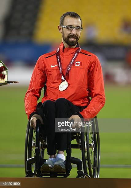 Brent Lakatos of Canada poses with his gold after the men's 200m T53 during the Evening Session on Day Four of the IPC Athletics World Championships...