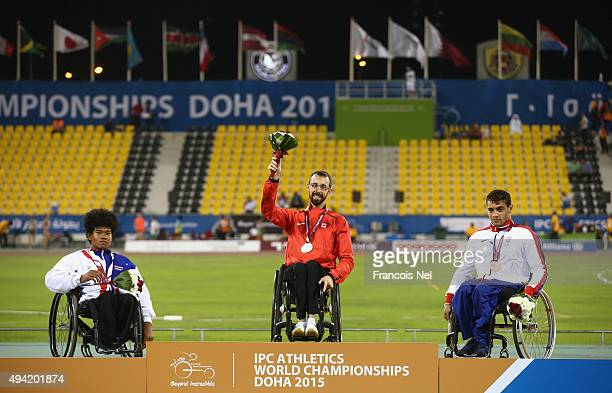 Brent Lakatos of Canada poses with his gold Pongsakorn Paeyo of Thailand silver and Moatez Jomni of Great Britain bronze after the men's 200m T53...