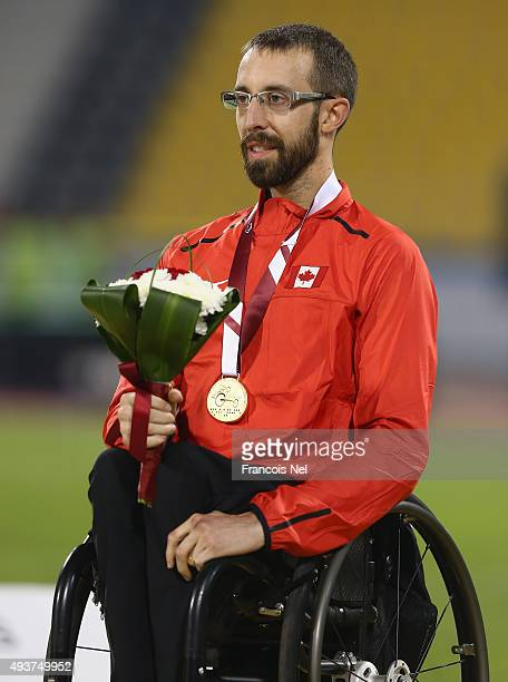 Brent Lakatos of Canada poses with the gold at the medal ceremony for the Men's 100m T53 Final during the Evening Session on Day One of the IPC...