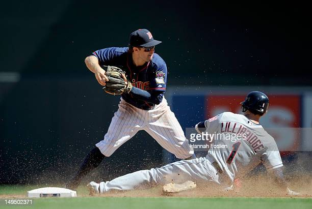 Brent Lillibridge of the Cleveland Indians is out at second base as Brian Dozier of the Minnesota Twins looks to turn a double play during the eighth...