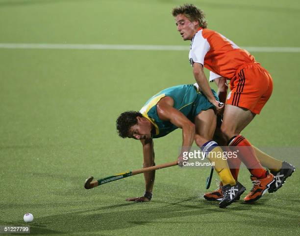 Brent Livermore of Australia and Rob Reckers of the Netherlands clash during the men's field hockey gold medal match on August 27 2004 during the...