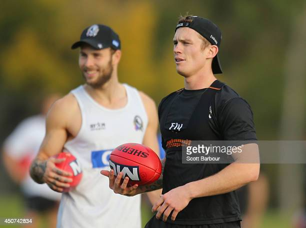 Brent Macaffer and Dayne Beams of the Magpies look on during a Collingwood Magpies AFL training session on June 17 2014 in Melbourne Australia