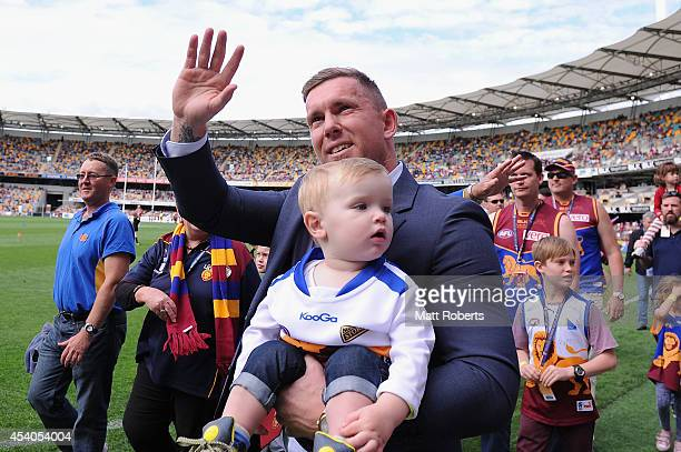 Brent Moloney of the Lions acknowledges the crowd at half time during the round 22 AFL match between the Brisbane Lions and the Fremantle Dockers at...