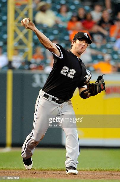 Brent Morel of the Chicago White Sox throws the ball to first base against the Baltimore Orioles at Oriole Park at Camden Yards on August 10, 2011 in...