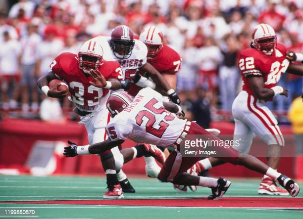 Brent Moss, Running Back for the University of Wisconsin Badgers runs the ball as Lance Brown attempts to tackle him during the NCAA Big Ten college...