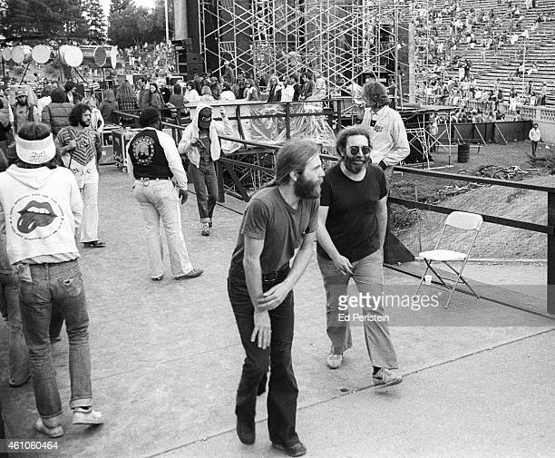Brent Mydland and Jerry Garcia leave the stage after performing with The Grateful Dead at Spartan Stadium on April 22 1979 in San Jose California