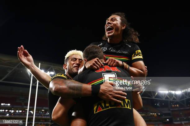 Brent Naden of the Panthers celebrates scoring a try with team mates Jerome Luai and Viliame Kikau of the Panthers during the round 23 NRL match...