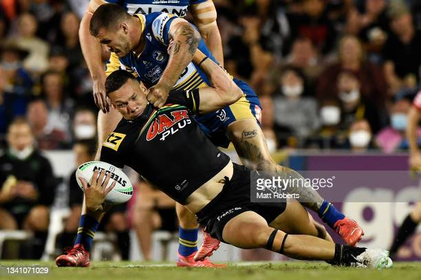 Brent Naden of the Panthers is tackled by Ray Stone of the Eels during the NRL Semifinal match between the Penrith Panthers and the Parramatta Eels...
