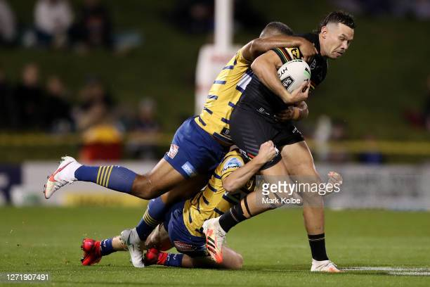Brent Naden of the Panthers is tackled during the round 18 NRL match between the Penrith Panthers and the Parramatta Eels at Panthers Stadium on...