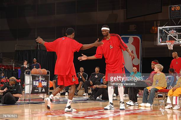 Brent Petway and Mike Taylor of the Idaho Stampede high five each other during the Slam Dunk Contest as part of the DLeague Dream Factory Friday...