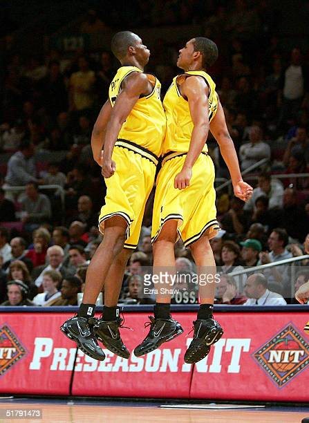Brent Petway and Ronald Coleman of Michigan bump chests after Michigan went up 2111 over Arizona in the first half of the Preseason NITsemifinals on...