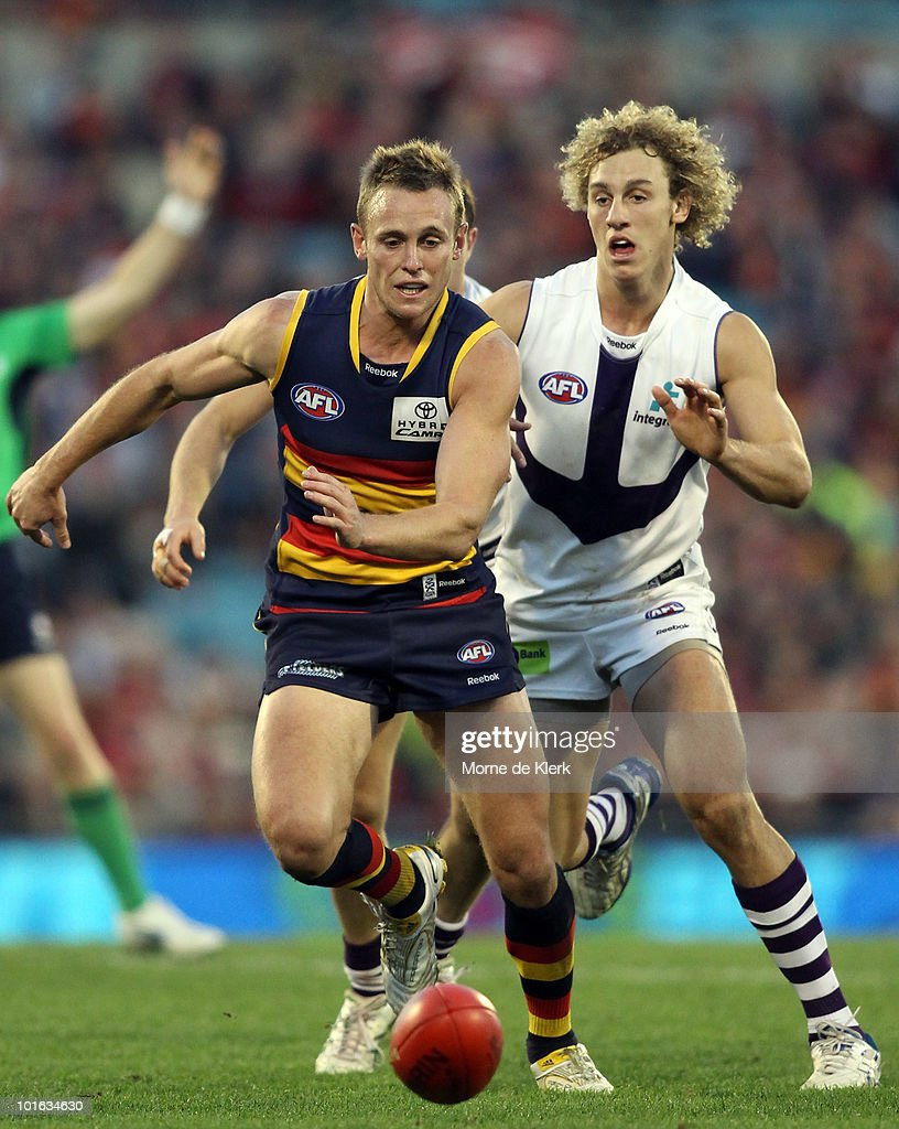 Brent Reilly of the Crows chased by Chris Mayne of the Dockers during the round 11 AFL match between the Adelaide Crows and the Fremantle Dockers at AAMI Stadium on June 5, 2010 in Adelaide, Australia.