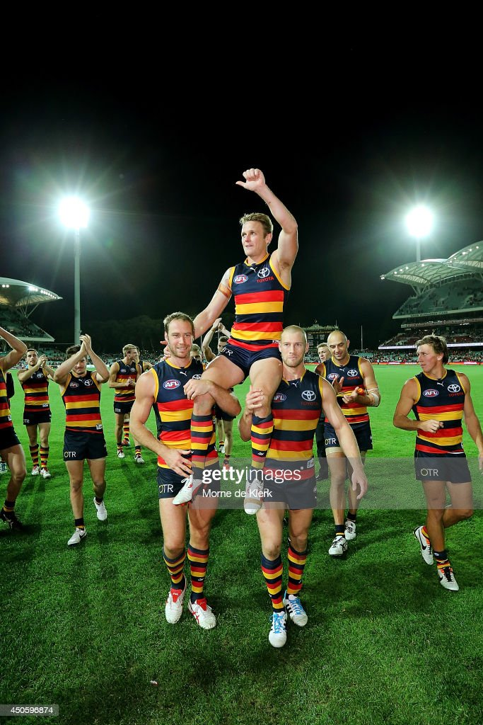 Brent Reilly of the Crows is chaired from the field after his 200th game after the round 13 AFL match between the Adelaide Crows and the North Melbourne Kangaroos at Adelaide Oval on June 14, 2014 in Adelaide, Australia.