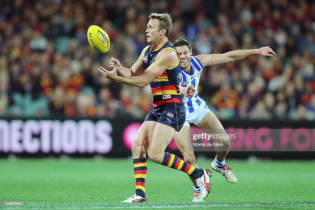 Brent Reilly of the Crows passes the ball during the round 13 AFL match between the Adelaide Crows and the North Melbourne Kangaroos at Adelaide Oval on June 14, 2014 in Adelaide, Australia.