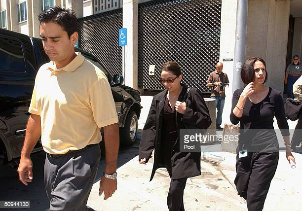 Brent Rocha his sister Amy Rocha and his wife Rose Marie Rocha leave the Redwood City California courthouse on June 9 2004 during the Scott Peterson...