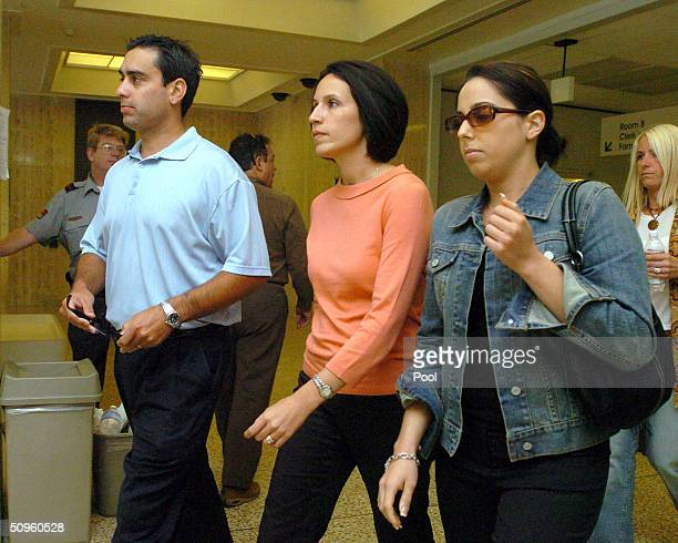Brent Rocha Rose Marie Rocha and Amy Rocha leave the San Mateo County Courthouse after court was adjourned for the day in the Scott Peterson trial...