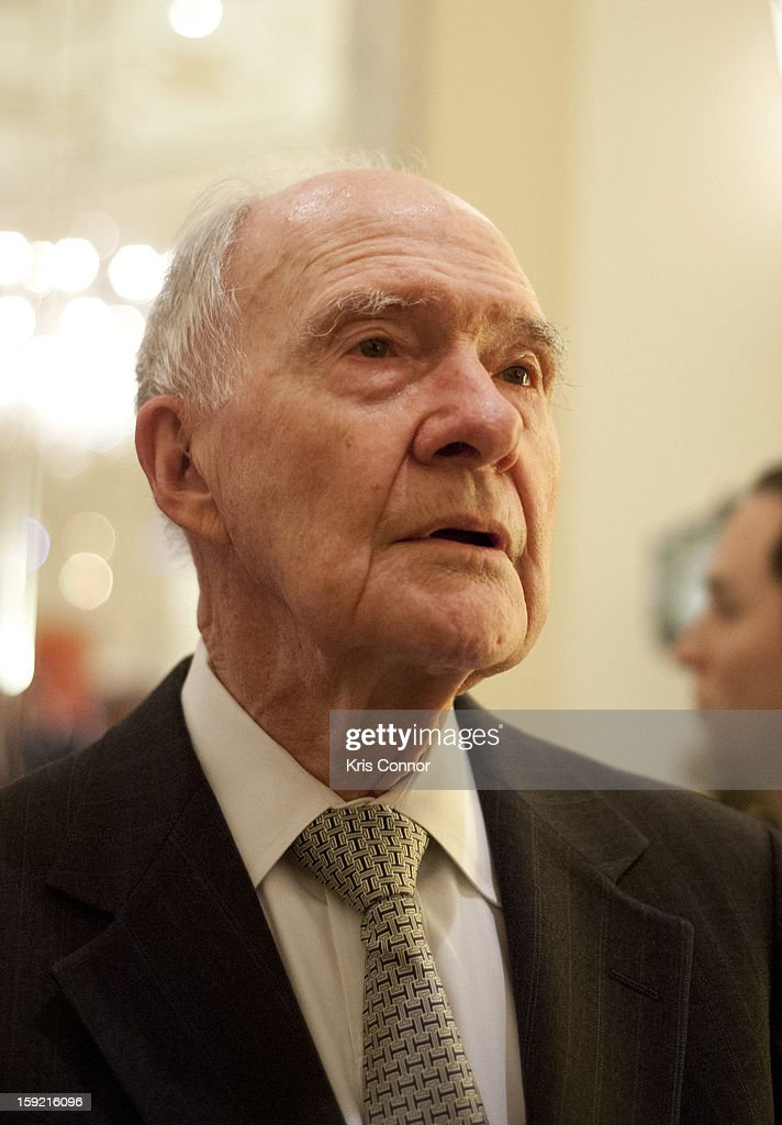 Brent Scowcroft speaks with a guest during President Nixon's 100th Birthday Gala on January 9, 2013 in Washington, United States.