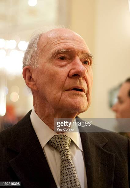 Brent Scowcroft speaks with a guest during President Nixon's 100th Birthday Gala on January 9 2013 in Washington United States