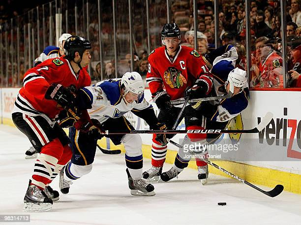 Brent Seabrook and Jonathan Toews of the Chicago Blackhawks battle for the puck with TJ Oshie and Brad Winchester of the St Louis Blues at the United...