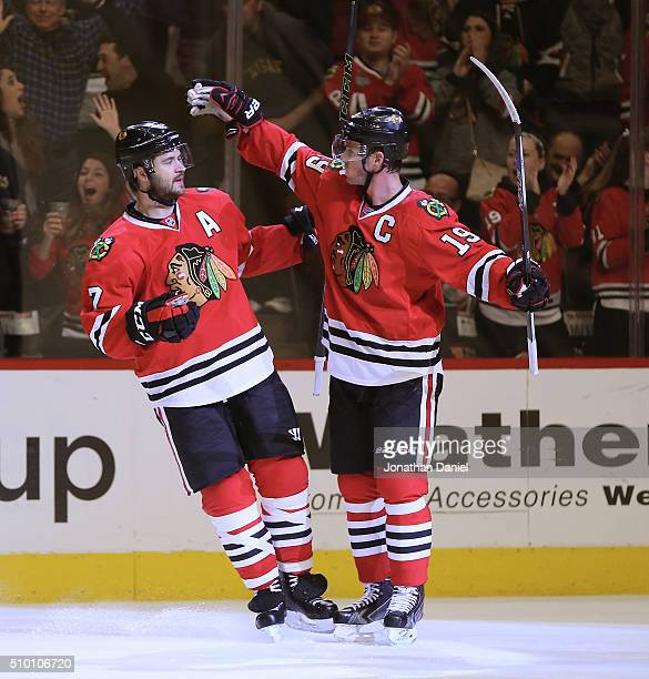 Brent Seabrook and Jonathan Toews of the Chicago Blackhawks celebrate a second period goal by Seabrook against the Anaheim Ducks at the United Center...