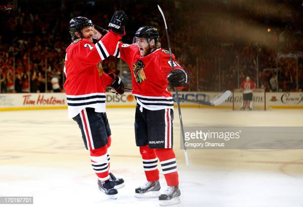 Brent Seabrook and Patrick Kane of the Chicago Blackhawks celebrate after Kane scored a goal in the first period against the Los Angeles Kings during...
