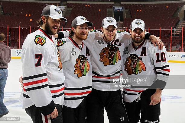 Brent Seabrook Duncan Keith Jonathan Toews and Patrick Sharp of the Chicago Blackhawks celebrate after the Blackhawks defeated the Philadelphia...