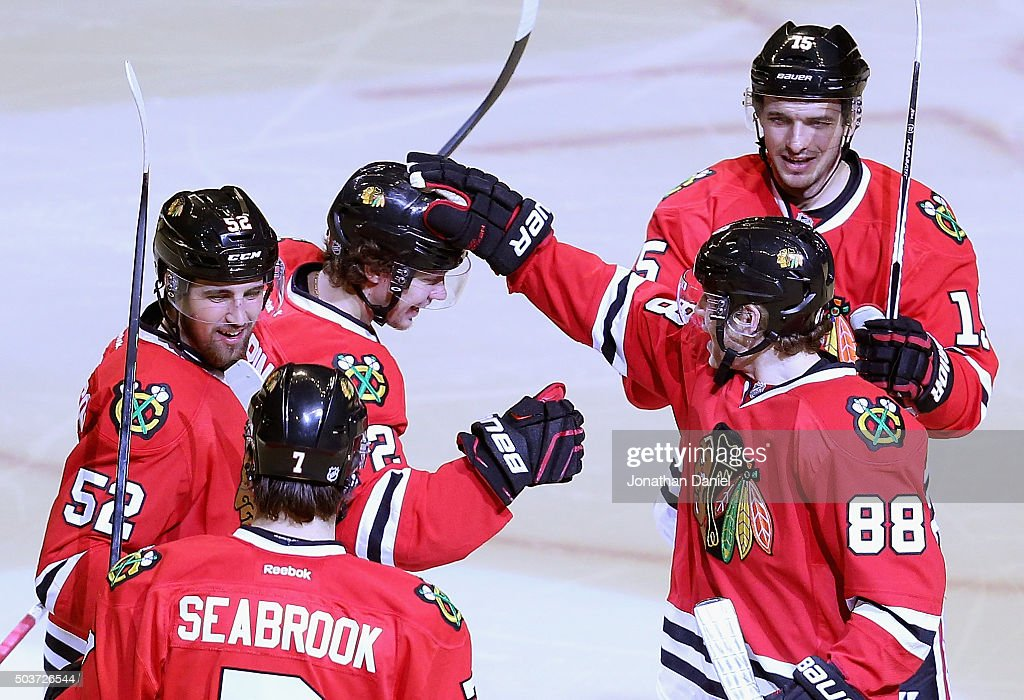 Brent Seabrook #7, Erik Gustafsson #52, Artemi Panarin #72, Artem Anisimov #15 and Patrick Kane #88 congratulate Panarin after his second goal of the game against the Pittsburgh Penguins in the third period at the United Center on January 6, 2016 in Chicago, Illinois. The Blackhawks defeated the Penguins 3-1.
